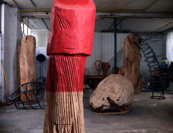 'Housewoman' cedar tree, paint, ht: 200cm